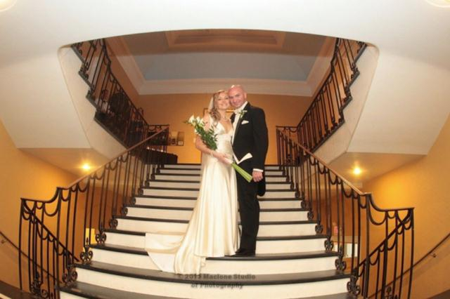 A bride and groom on the staircase of the Berkshire Museum