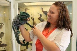 Image of educator and a chameleon puppet