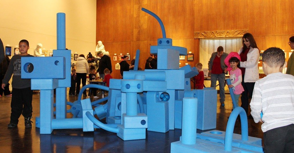 Kids use the big blue blocks of Imagination Playground to build sky high.