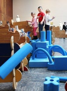 Children combined Imagination Playground with a Bilderhoos building set for extra fun.