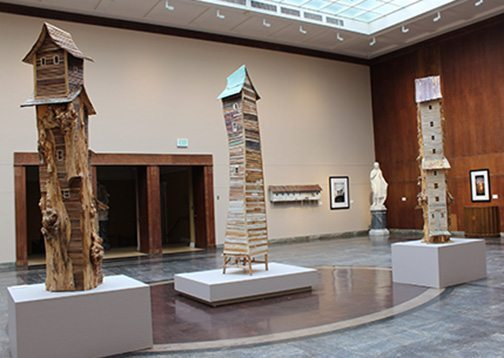 Robert Hite, Slab Tower, 2014; River Tower, 2009; and Black Willow Tower, 2014/2015, all mixed media.