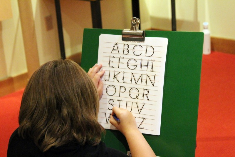 Child writing the alphabet